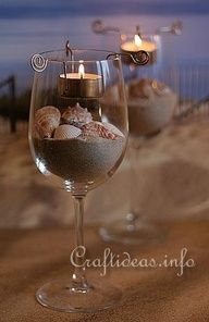 DIY beach wedding reception table centerpiece décor/ floating candle in water