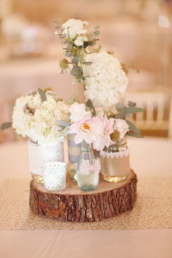 mismatched vases on wood stump http://www.weddingchicks.com/2013/10/11/alabama-wedding/