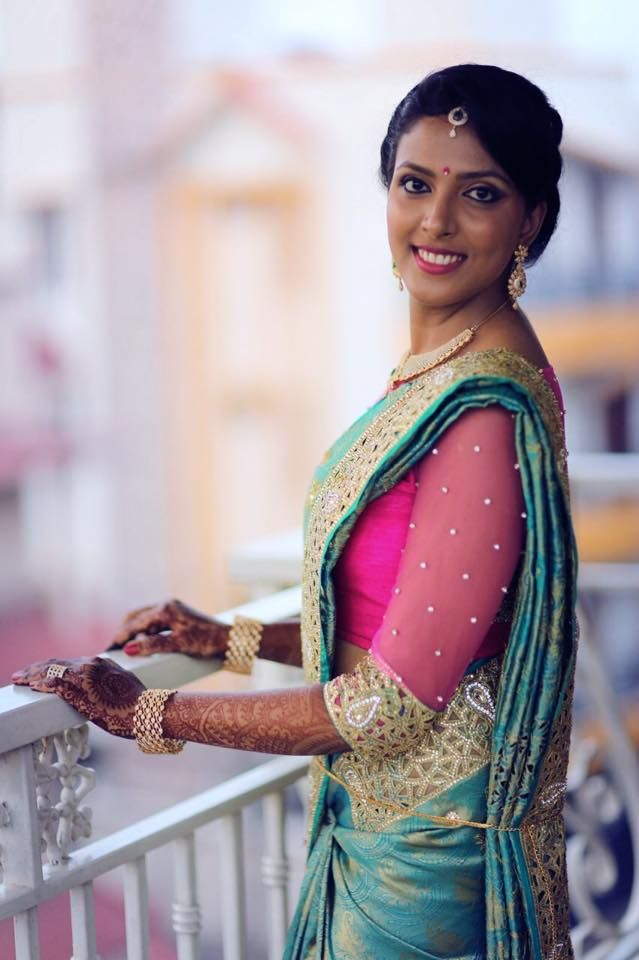 South Indian bride. Temple jewelry. Jhumkis.Blue teal silk kanchipuram sari with cutwork and contrast pink sheer blouse.Braid with fresh jasmine flowers. Tamil bride. Telugu bride. Kannada bride. Hindu bride. Malayalee bride.Kerala bride.South Indian wedding.