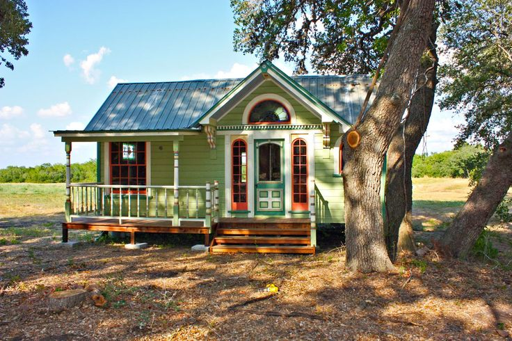 Tiny Texas Houses: This is a 12' x 26' house we call the Painted Lady because of the 6 colors she is painted with. It has a great layout with a Murphy Bed and a upstairs loft for a bed as well. The full kitchen had an under counter Sub Zero fridge/freezer. The glassed in shower had 1890's circa galvanized interlocking roofing shingles and a river rock floor. The house has front and back porches with a split air conditioning system that is nearly silent and cools the place with high effic...