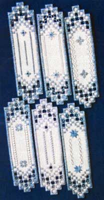 """NEWEST!  This Hardanger chartpack has six fresh bookmark designs that are great for using threads and fabrics in your stash.  The design size is 2"""" x 7.5"""" on 22-count fabric. Supplies required as shown:  22-count Antique White Hardanger (1008-101)   DMC Size 5 Pearl Cotton: 932      Underline  denotes products not included in kitting function."""