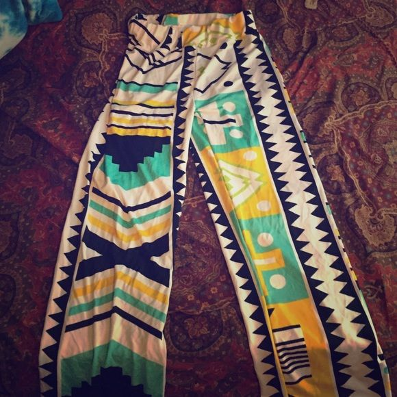 Aztec pants 37 inches top to bottom. 12.5 waste. Very stretchy. No flaws. Too short on me - Pants