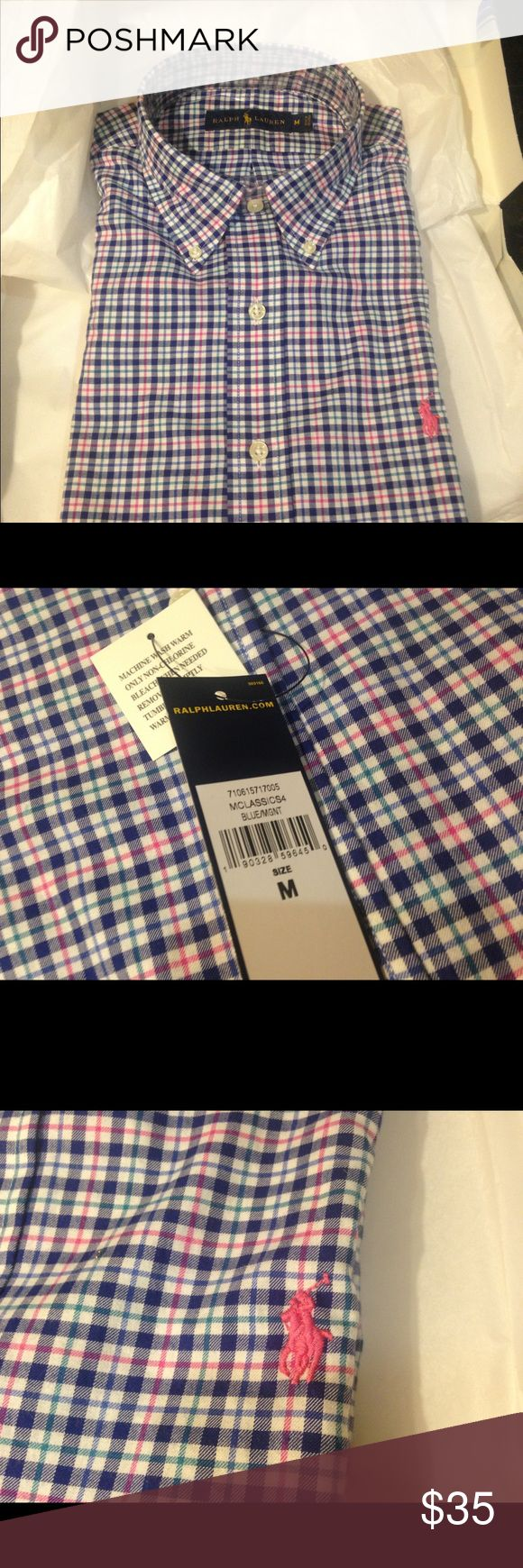Men's long sleeve polo shirt NWT with tags. Men's long sleeve Polo shirt new with tags. Shirt has navy blue, green, and pink strips with a pink polo emblem. Polo by Ralph Lauren Shirts Polos