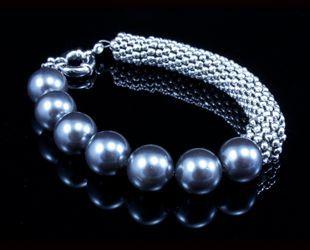 Como hacer pulseras con perlas