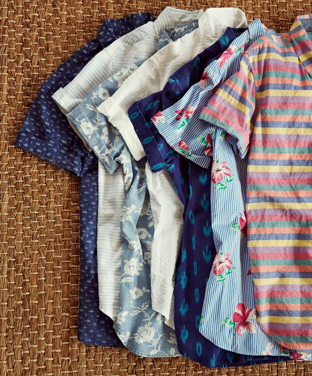 I like the patterned short sleeve button downs you already have. Maybe layering with them or adding accessories could make them look even more intentional