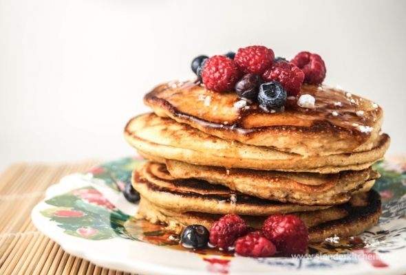 Polenta pancakes with berries made with Greek yogurt and delicious - also freeze great for quick breakfasts on the go.  And 3 pancakes is just 250 calories
