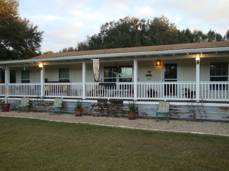 Manufactured home porch addition- notice the antique tin skirting.