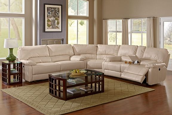 Ralston Vanilla Leather Collection | Furniture.com. Cream bonded leather 3 piece power reclining sectional with storage console cup holders.