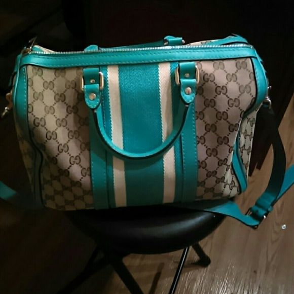 Gucci authentic bag Authentic bought it from neimen Marcus, Vintage Boston bag style!! with strap silver zipper n hard wear beautiful condition one tiny faded stain from cola u can slightly see on under body of bag teal blue 100% real Gucci ,paid 1,100$ from Gucci counter neimens 3 yrs ago it since has went up in price Gucci Bags Shoulder Bags