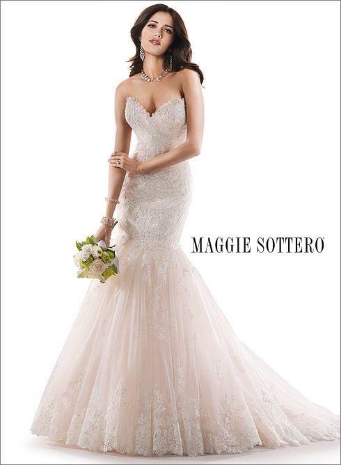 Maggie Sottero Marianne, available at Chantilly Place. Beautifully embellished lace adorns this dramatic fit and flare, with a sweetheart neckline and subtle sparkle. Finished with signature corset back closure.