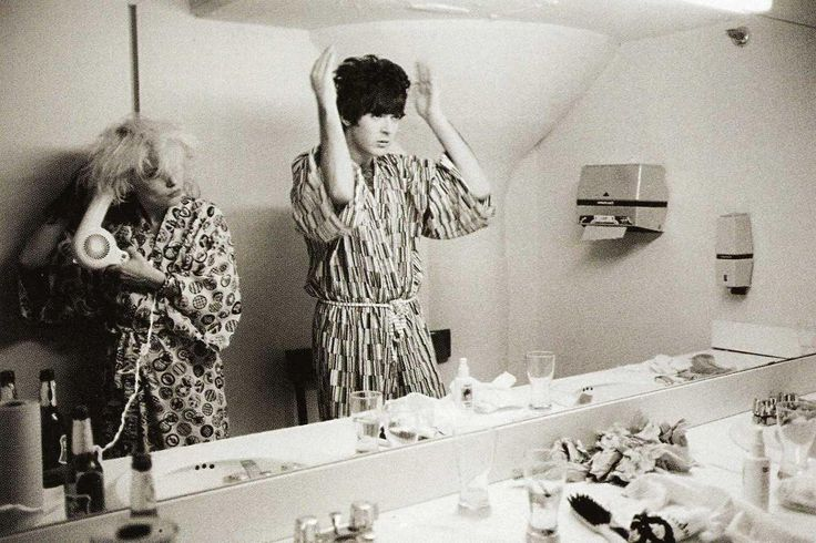 Debbie Harry and Clem Burke of Blondie preparing for a show in 1977