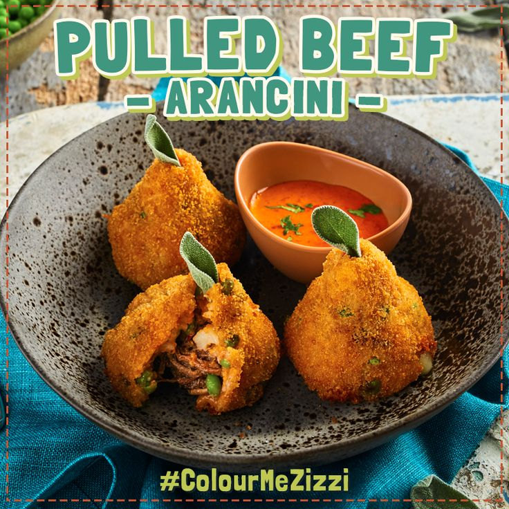 Pulled Beef Arancini freshly made risotto balls with a slow cooked pulled beef & melted mozzarella middle & breadcrumb coating. Served with a smoked capia pepper dip. #ColourMeZizzi