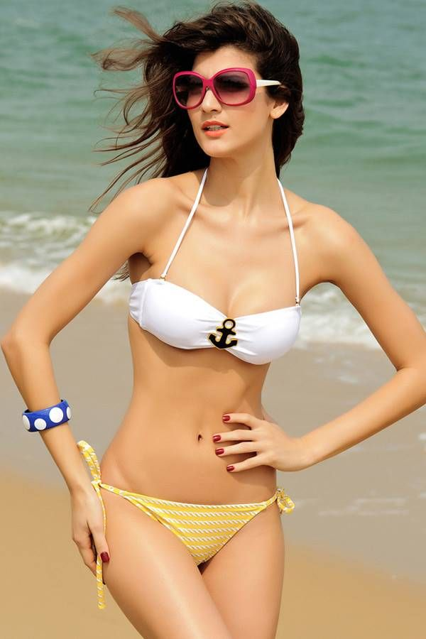 A model raises temperatures in a colour co-ordinated bikini during the photoshoot.(Source: www.n-gal.com)See more of: Hotties In Bikini