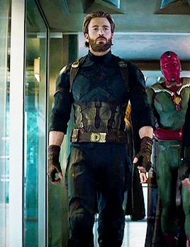 1. Who is walking behind cap and 2. WHY DOESNT VISION HAVE THE INFINITY STONE IN HISHEAD??!!?!?!?!?
