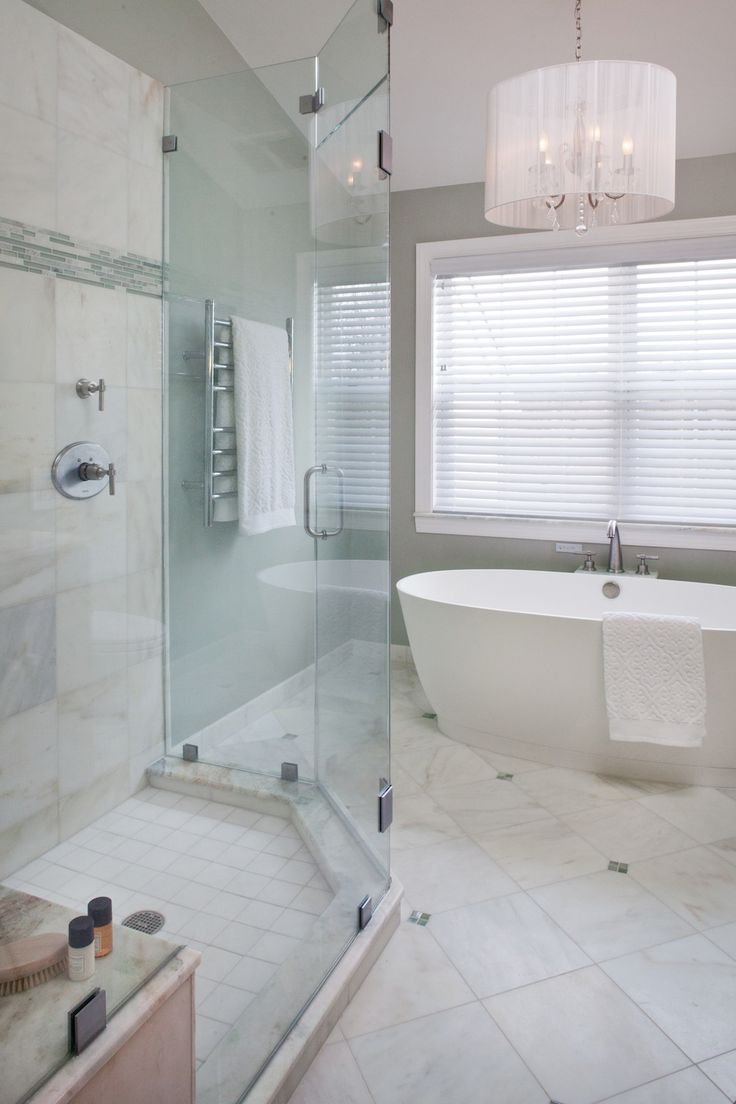 Stand Alone Bath Tub With A Multi Functional Glass Shower
