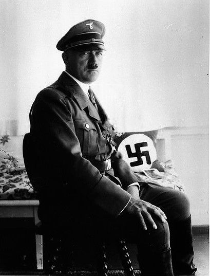 This one is usually cropped. Hitler in September, 1933.