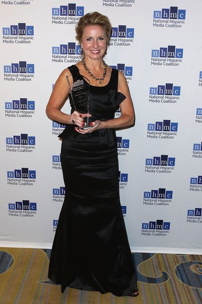 Producer/director Catherine Tambini wins 'The Outstanding Documentary Impact Award' for 'Hate Rising' during the 20th Annual National Hispanic Media Coalition Impact Awards Gala at Regent Beverly Wilshire Hotel on February 24, 2017 in Beverly Hills, California.