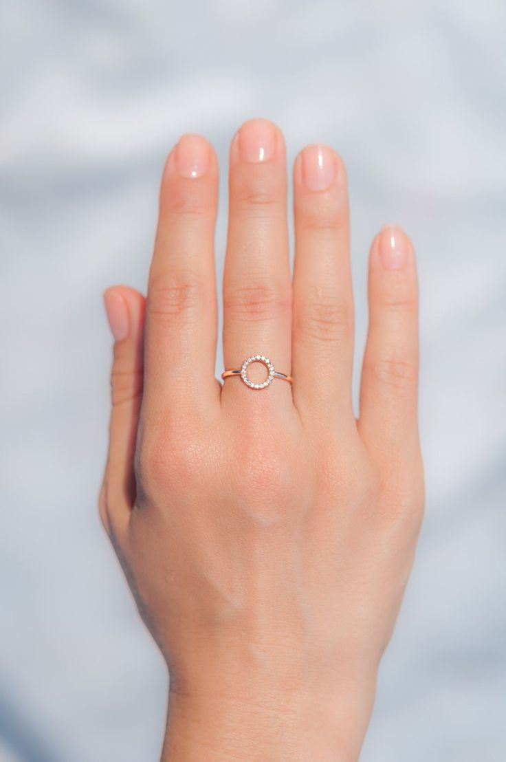 Whether you're more of a traditional bride-to-be or one who likes to think outside of the box, we found a wide variety of engagement rings that go from simple and unique, to show stopping gorgeous. So don't be shy, keep clicking to see every last one. Nothing says forever like this minimalist circle diamond ring from milajewellerydesign. It's dainty circle design is filled with 20 sparkly pave diamonds set in your choice of 14k yellow, white or rose gold. Shop Nowmilajewellerydesign