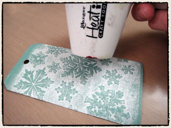 Use embossing ink before running your cardstock through embossing machine. Wonderful effect. This page has tutorial for an awesome Christmas tag by the amazingly talented Tim Holtz.