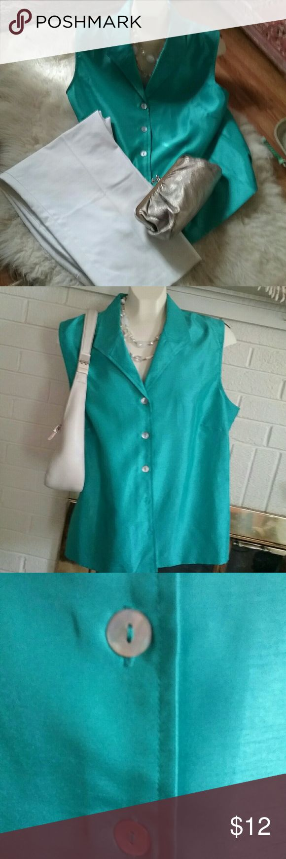 Crisp sleeveless turquoise shirt EUC Like new. Polyester but looks and feels totally like silk- fabric is slubbed (see pic), and has a lovely weight. Pretty abalone buttons. Buttons all the way down. Fitted with darts and in back. Really nice summer top. Scarlett Tops