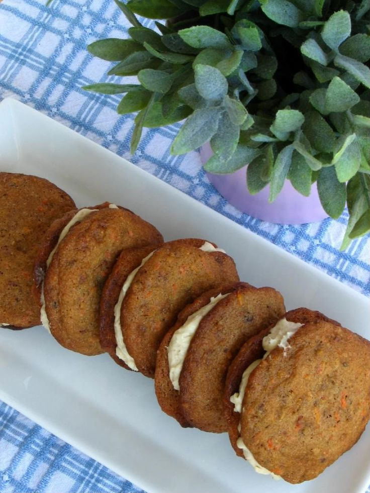 Love this site- funny stories and yummy looking recipes!  These are Carrot Cake Sandwich Cookies w Honey Cardamom Cream Cheese