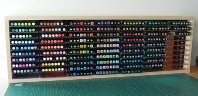 what a nifty way to store your markers i never would of thought about that. just need wood CD holder and the CD jewel cases. and extremely cheap!