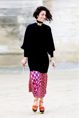 Oversized turtleneck worn with a printed skirt and choker necklace