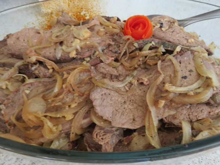 Easy Roast Beef Recipe - This easy roast beef recipe is made with a tougher piece of beef such as chuck or shoulder roast. It requires very few ingredients and cooks very slowly in the oven. The final result is a tender piece of beef that is smothered in caramelized onions and garlic.