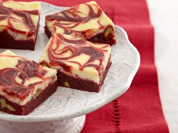 OMGoodness, I bet these go real well with a nice glass of cold milk : )  Red Velvet Swirl Brownies from FoodNetwork.com