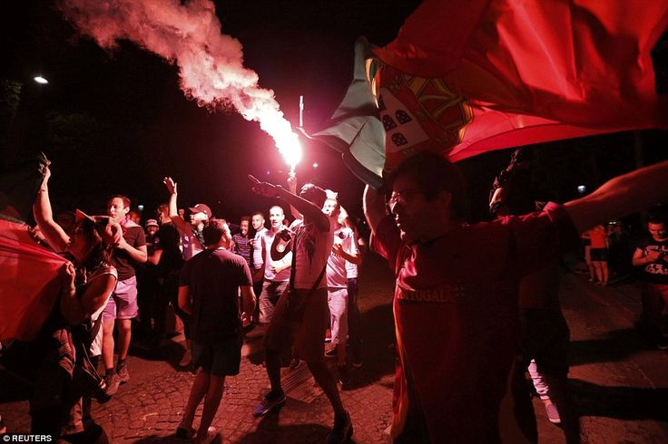 Fans brandish flares and dance in celebration of Portugal's first ever international tourn...