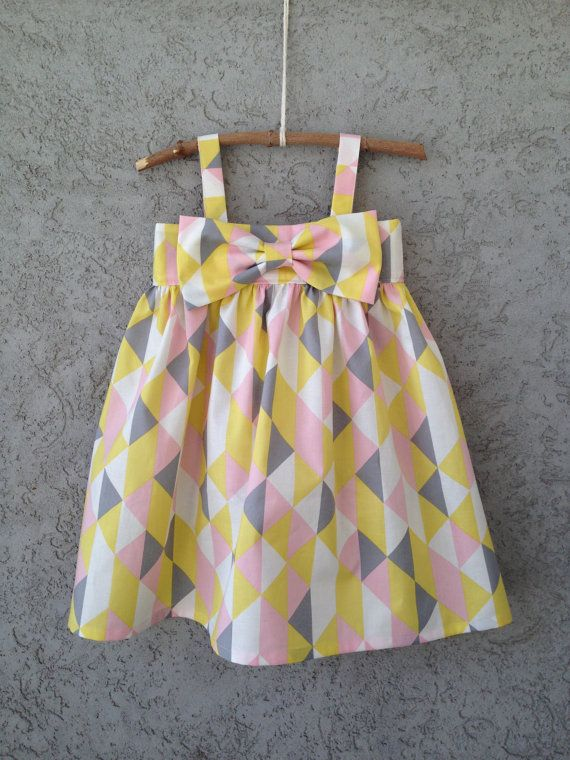 fresh and modern triangle geometric print dress in yellow, pink, grey, and white
