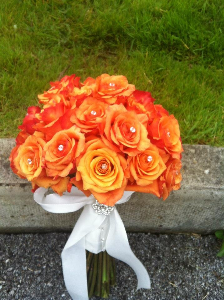 Orange Roses Bouquet - no, ribbon, or frou-frou. Keep it simple.