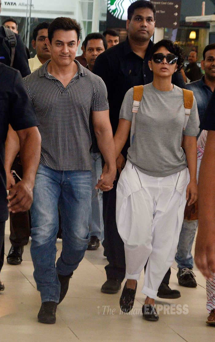 Aamir Khan arriving hand-in-hand with wife Kiran Rao at Mumbai airport.