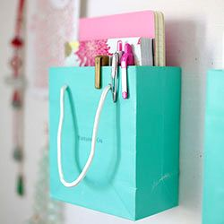 Use cute shopping bags that you collect to help organize your life! Use them as organizational compartments for pens, journals, cards, etc.