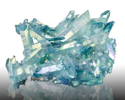 Aqua Aura Quartz; Arkansas Like Rainbow Aura Quartz, Aqua Aura Quartz is an artificially enhanced crystal—in this case, it is bonded with a coating of gold.