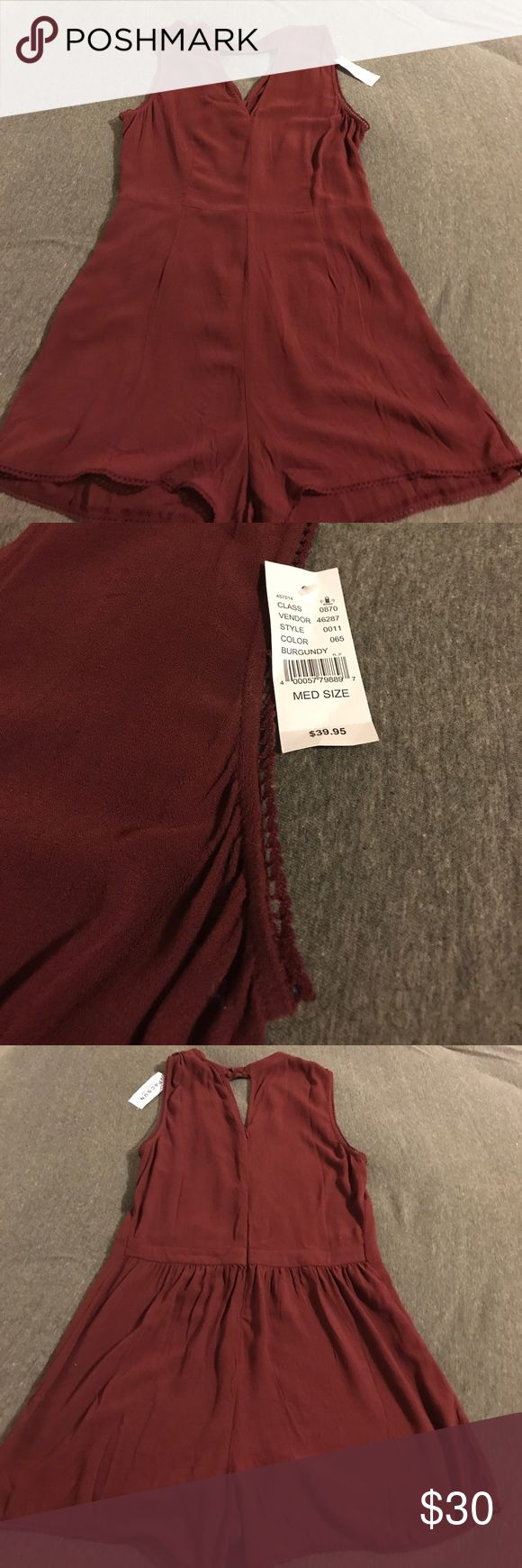 Pacsun Kendall&Kylie Romper w Choker Neckline This is a brand new never worn romper from PacSun with the tags still on. It's a dark red/maroon color with a high neck and choker neckline and a cutout near the chest. I around the edges there's a pretty sewn detail. Zips up the back and buttons on top. Really pretty- can be worn casually or dress up for any event. (Not a set price, send me your offers. I accept bundling as well!) PacSun Dresses