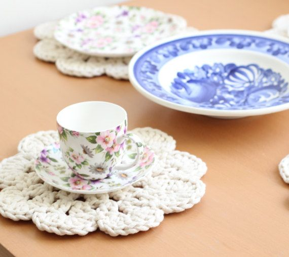 Set of 4 big crochet coasters in cream.  Made with thick but elastic cotton rope. Big size of coasters made them universal. They fit under a cup, dessert and dinner plate. Theye are perfect to use for breakfest, dinner and every occasion like birthday and holidays. Genuine crochet pattern and its shape make the coasters very original. They are unique table decorations. You can put them in a washing machine, hen iron them in middle-high temp. It is necessary to iron coasters after washing…