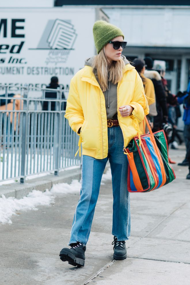 Street style at Fashion Week fall-winter 2017-2018 New York yellow down jacket