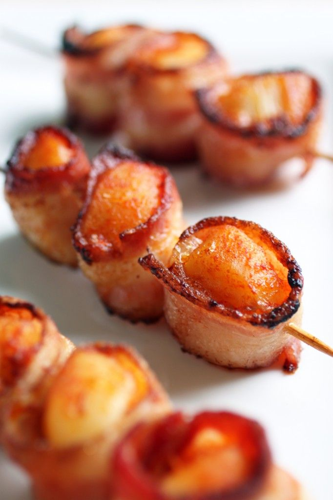 Bacon-wrapped scallops - Preheat oven to 425°F; rinse scallops under cold water; cut bacon strips in half and wrap each scallop; skewer 2–3 on a skewer and sprinkle with smoked paprika, seasoning both sides. Bake for 20 minutes, flip, then bake for an additional 15 minutes. | The Food Lover's Kitchen