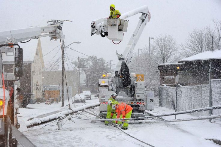 On Riverside Avenue, a Brockton car smashed into a utility pole on Friday, Feb. 5, 2016. In a 12-hour period Friday, the Brockton Police Department responded to 43 motor vehicle accidents, received 22 reports of downed power. — Marc Vasconcellos/The Brockton Enterprise