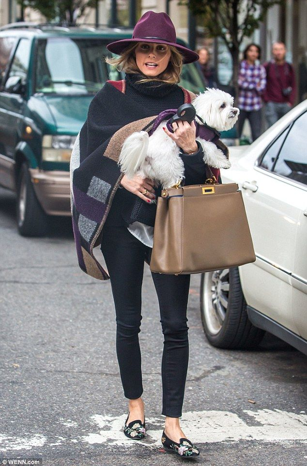 A girl's best friend! Olivia Palermo made sure to coordinate with her dog, Mr. Butler, as he accompanied her on an outing in Brooklyn, New York on Tuesday - http://AmericasMall.com