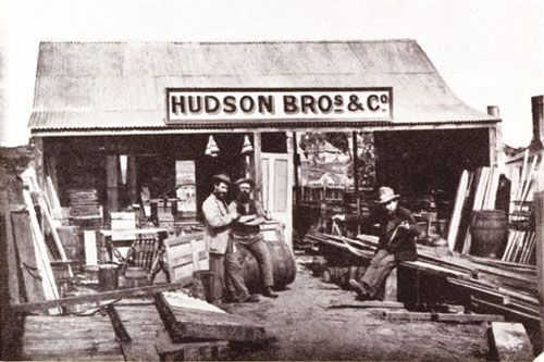 Hudson Bros, Hill End, NSW shows the complete stock of a typical builder's yard in 1872:  galvanised iron, staircase uprights, and ready-made doors, Australian ovens and casks of nails with everything dumped just as it was unloaded from the bullock waggons.