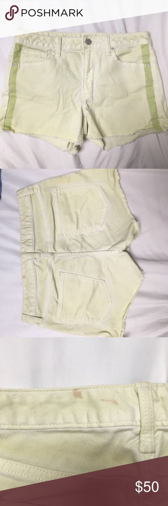 Green gap slim cut-offs Super cute flattering green slim cut off shorts with darker green stripes on the sides. Slight stain on the back, would be covered with a shirt, barely visible. GAP Shorts