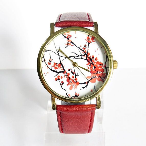 Cherry Blossoms Floral Watch, Vintage Style Leather Watch, Women Watches, Boyfriend Watch, Genuine Leather Ships Worldwide Type: Quartz Adjustable from 16.5 cm to 20.3 cm (6.50 inches to 8.0 inches) . If you want additional holes for adjustment, please make a note upon checkout or send me a convo Display: Analog Dial Window Material: Glass Case color: gold Case Material: Metal Case Diameter: 3.8 cm (1.49 inches) Case Thickness: 0.7 cm (0.27 inches) Band Material: Genuine leather Band Width…