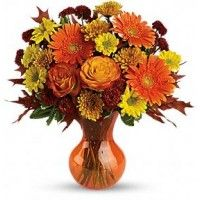 yellow flowers in a bright orange Serendipity vase! You won't find a more cheerfully charming party gift. Beautifully affordable,