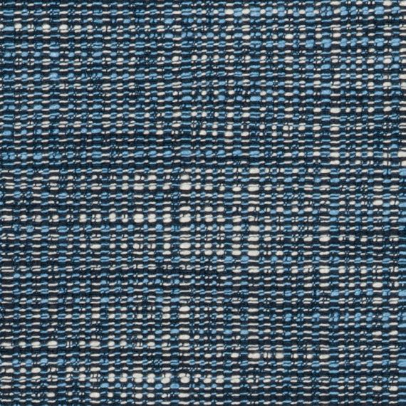 A woven tweed upholstery fabric in navy blue, chambray blue and ivory. This durable home decor fabric is suitable for all furniture upholstery,