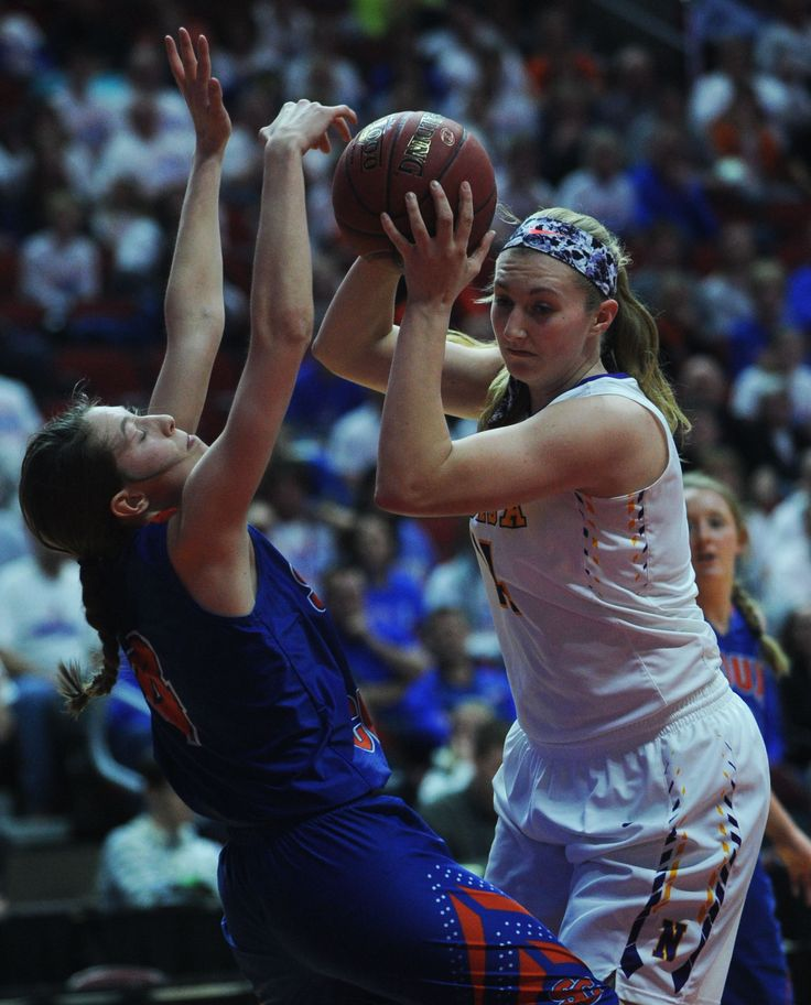 Nevada's Lexy Koudelka drives to the basket around Sioux