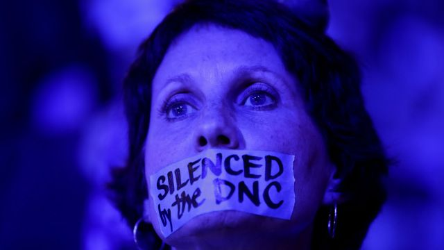 "Tape covering the mouth of a delegate from Michigan reads ""Silenced By DNC"" on July 25, 2016, the first day of the Democratic National Convention, in Philadelphia. (Photo by Chip Somodevilla/Getty Images)"
