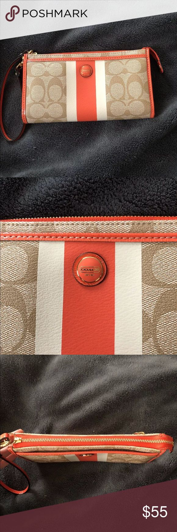 Authentic coach wristlet wallet Excellent condition! Used a few times after tags came off. No marks or wear. Has 6 credit card slots and a few more pockets inside. Has a zipper pocket outside and a pocket on the front. Orange, tan, and cream. Pet friendly smoke free home. Coach Bags Wallets
