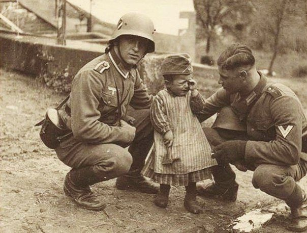 Two German soldiers trying to stop the tears of this russian child.''We don't know where your parents went, but perhaps there's a place for you in Alfred Rosenberg's Heuaktion or in Dr. Todt's factories''